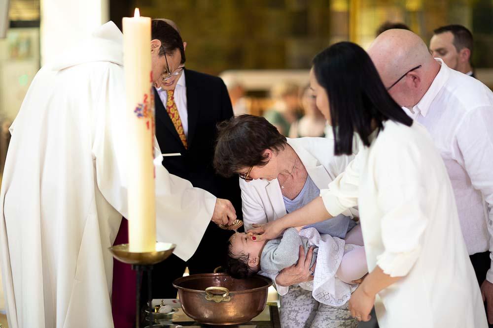 Photographe Baptême baptise eau